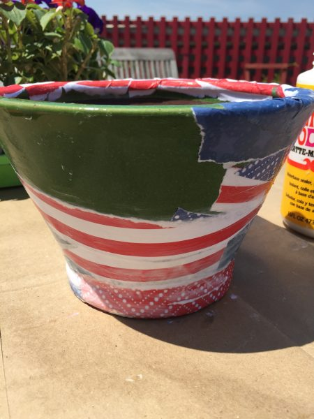 Halfway finished decoupaging planter pot