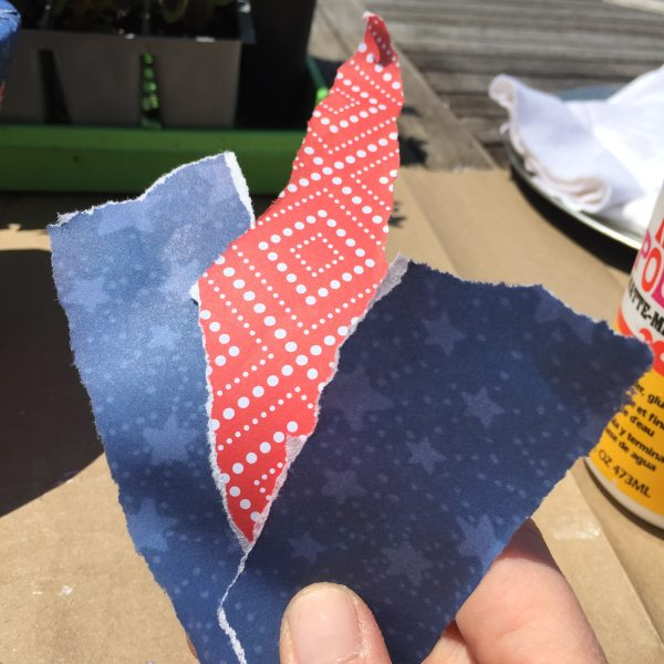 Ripped patriotic colored paper