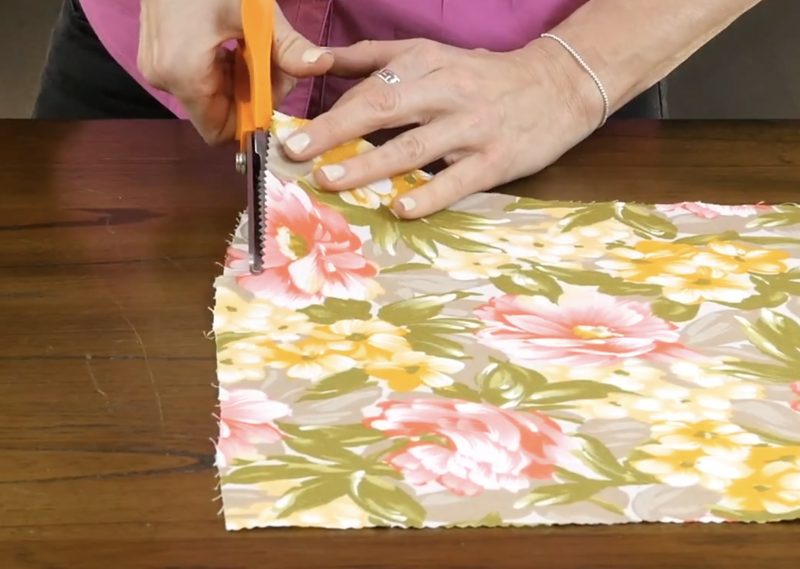 Cutting fabric with pinking shears