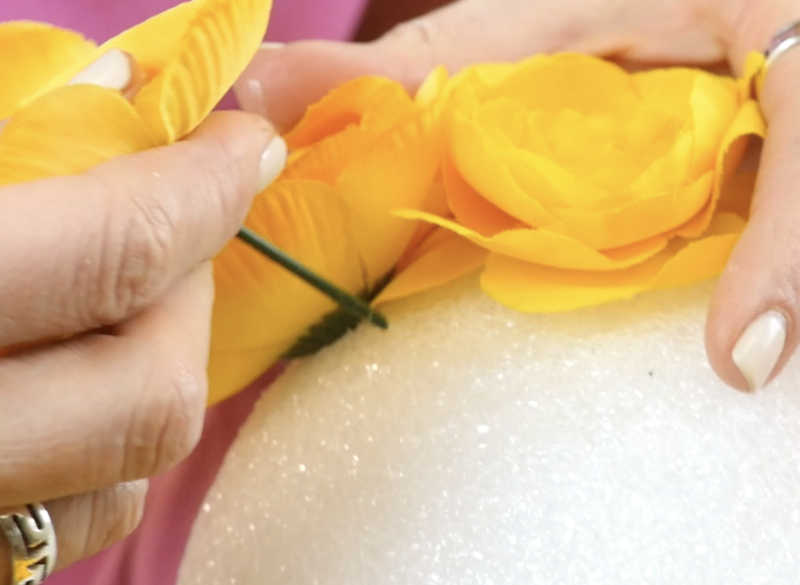 Insert flowers stems into foam ball