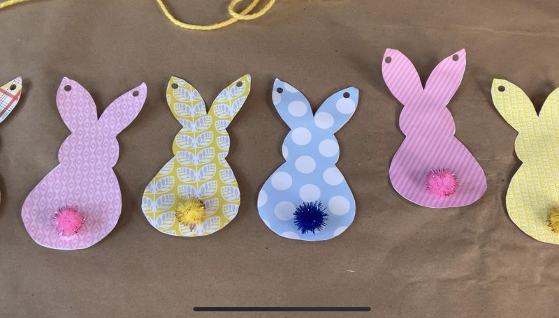 Step 4: adding pom pom tails to the bunny cut outs