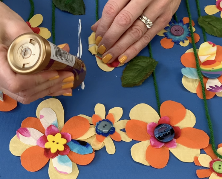 Gluing flowers and stems on canvas