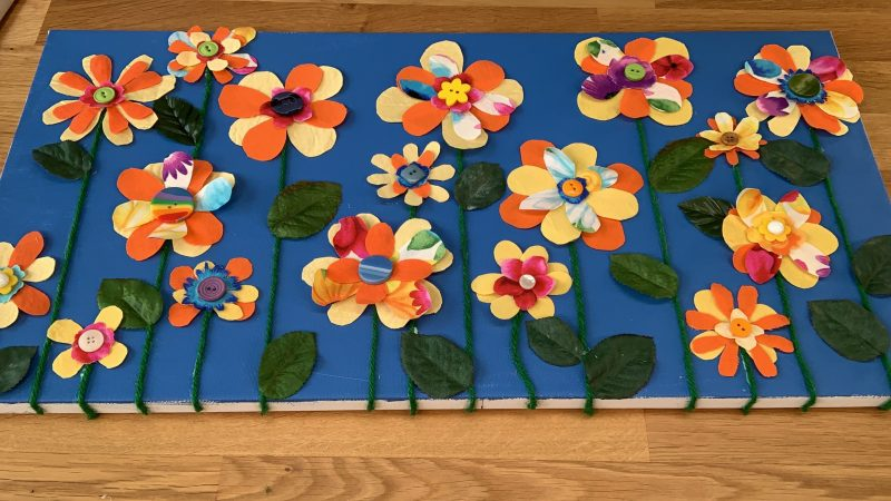Completed floral canvas on work table