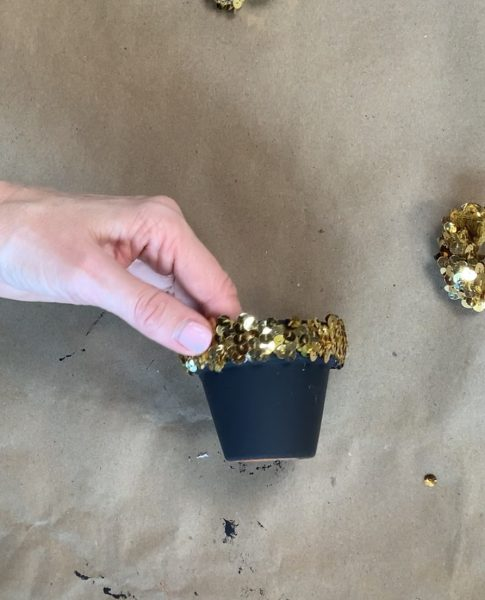 Gluing glitter trim on painted pot