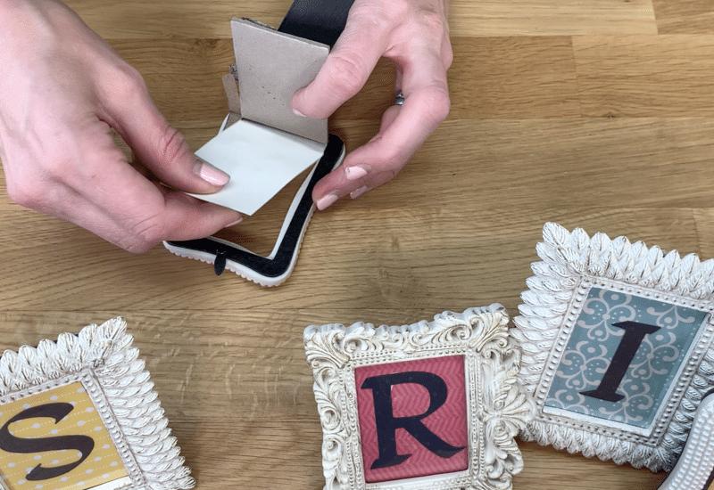 Insert letter blocks into the frames