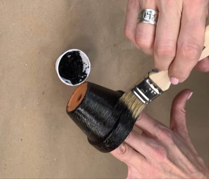 Painting the small terra cotta pot black
