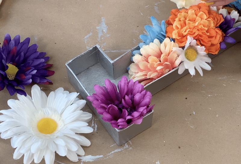 Flowers inside letter for positioning