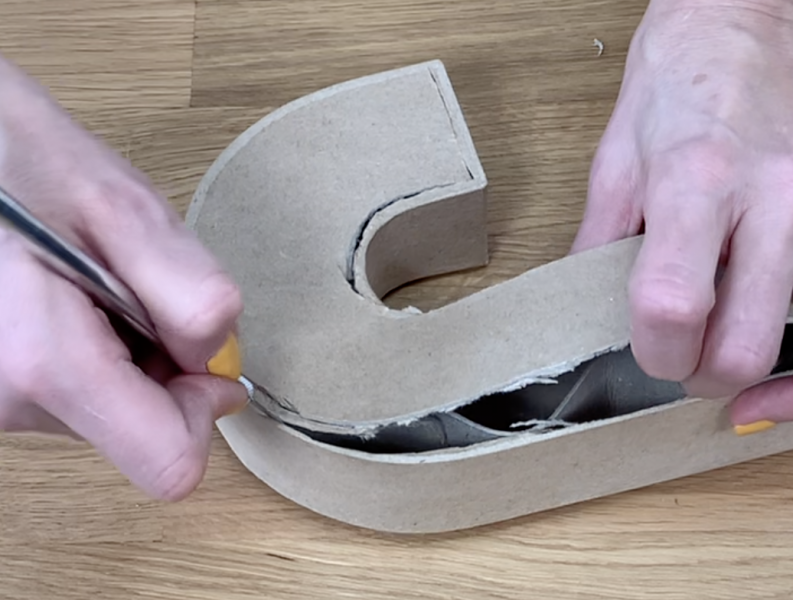 Cutting the front face off the 3D cardboard letter