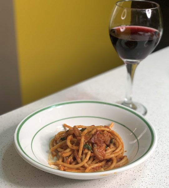 Home cooked Pasta Amatriciana with wine