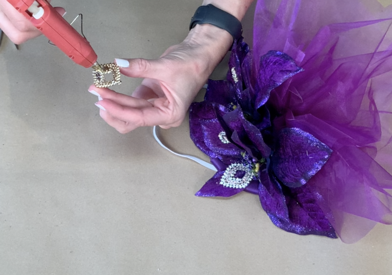 Adding costume jewelry to the fascinator