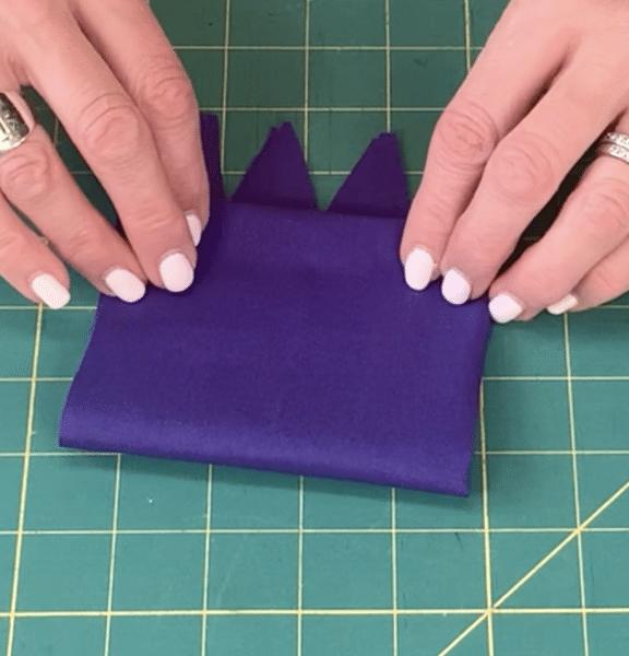 Folding top edge down to meet the bottom